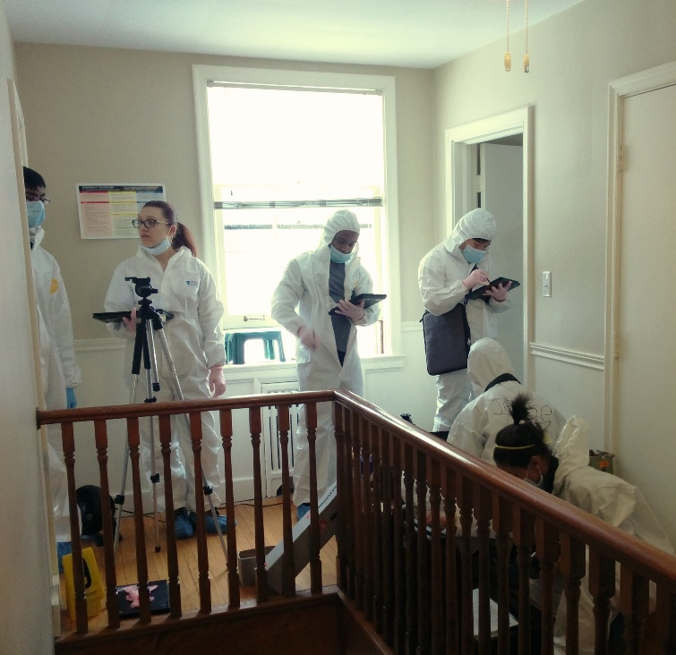 Students taking photos in the crime scene house