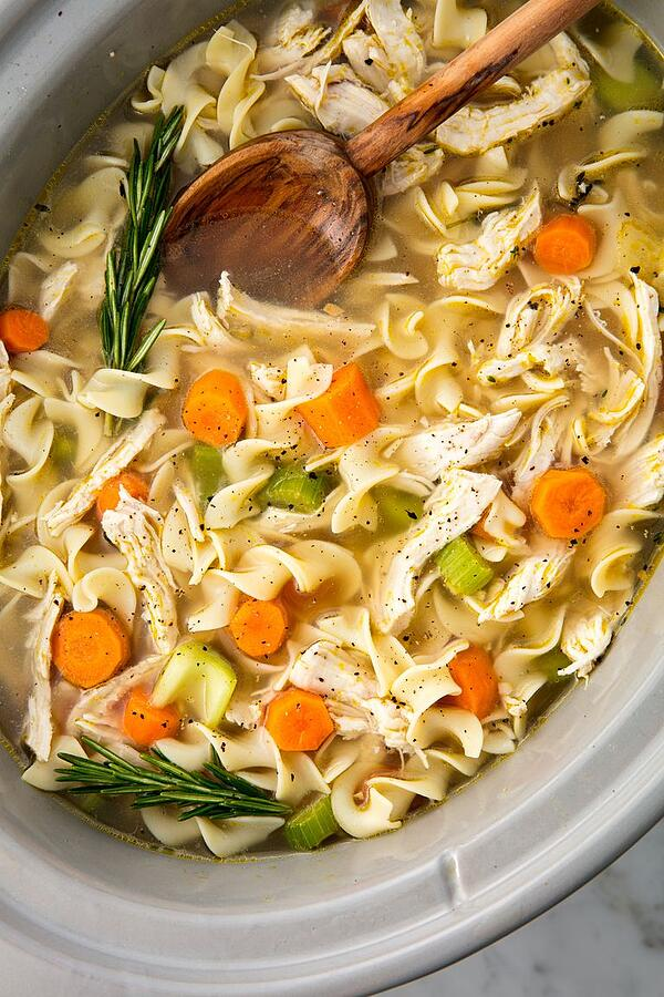 crock pot of chicken noodle soup