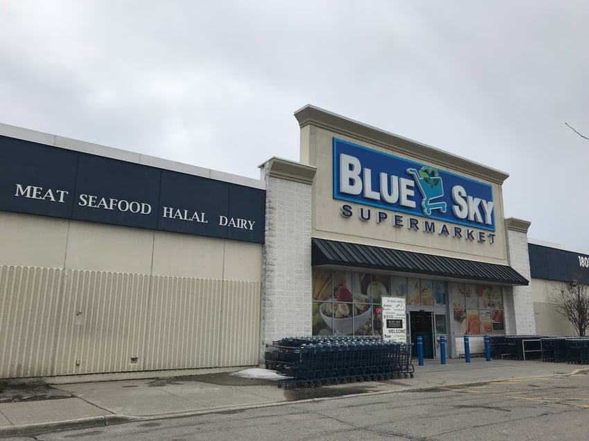 Outside of Blue Sky Supermarket storefront