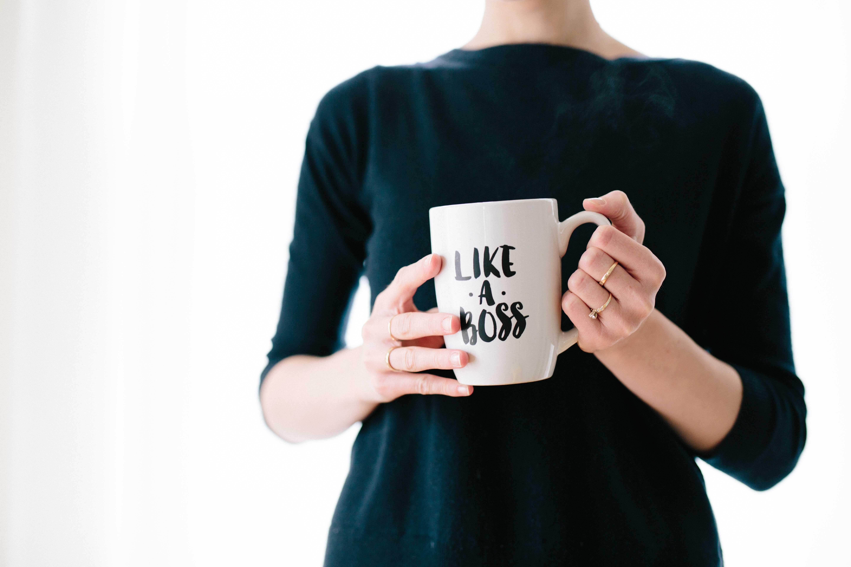 woman holds a mug