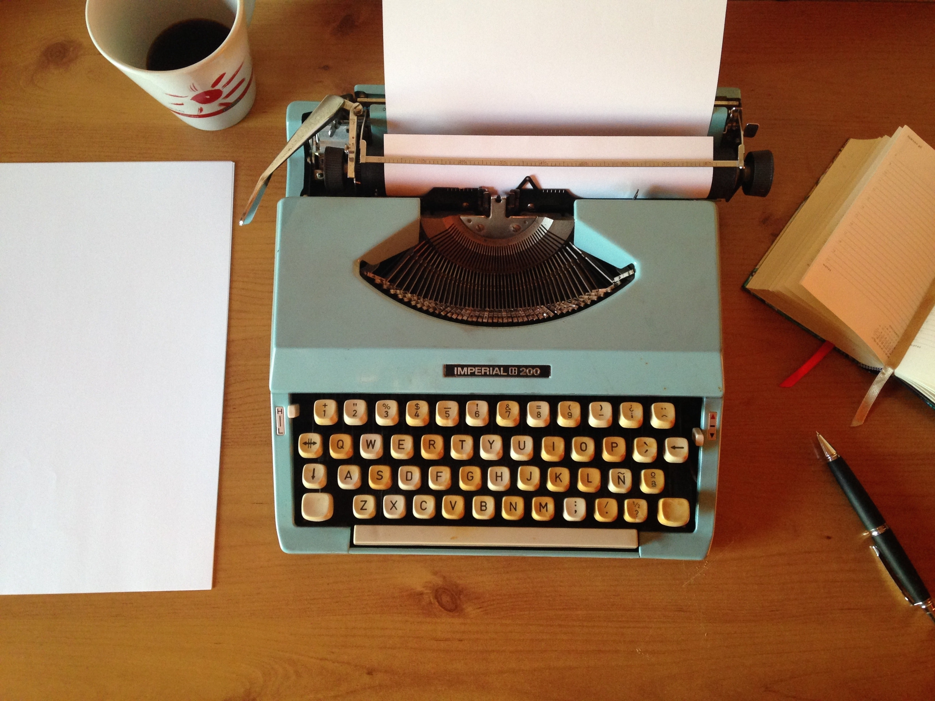 a typewriter sits on a table