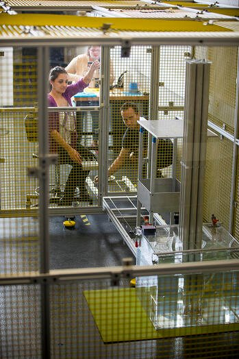 Students working in a radioactive cage at Ontario Tech