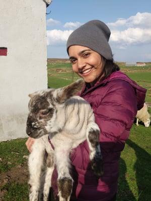 Zahra holding a goat