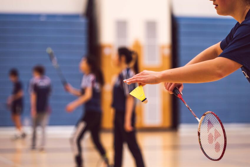 Group of people playing badminton