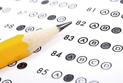 Pencil resting on a multiple choice test