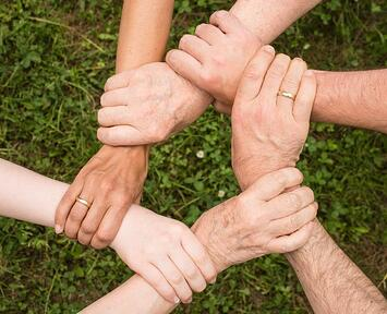 close up of people's hands holding each other's wrists
